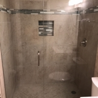 Island Echoes Glass shower door installation